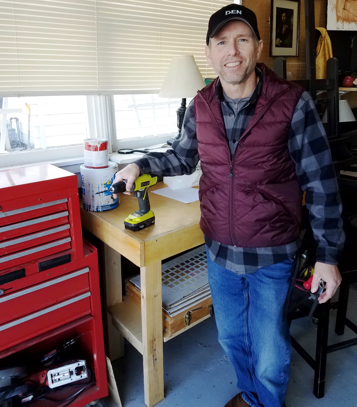 Steve Ulrich, owner/operator of 4 Lakes Handyman, LLC, in his Madison, Wisconsin workshop.