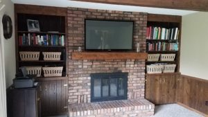 TV Mount over fireplace on brick wall