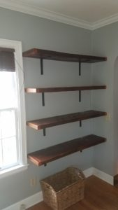 Reclaimed barn wood used for wall shelves